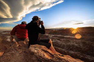 Two travellers admiring the view of Atacama desert in Chile all year