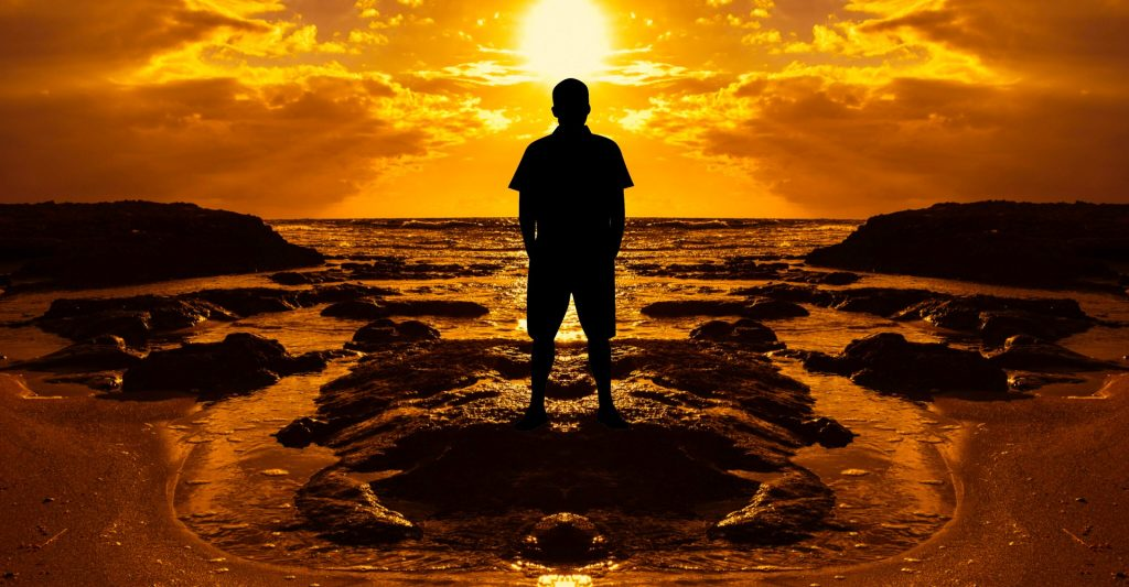 Silhouette of a man on beach at sunset visiting chile all year