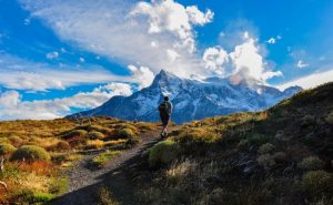 A hiker amongst the mountains in chile. Clear blue skies and snow capped mountains